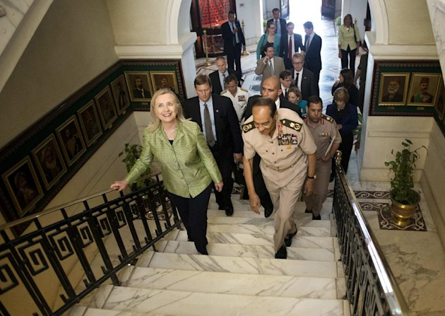 Field Marshal Hussein Tantawi walks with US Secretary of State Hillary Rodham Clinton to a meeting at the Ministry of Defense July 15, 2012 in Cairo, Egypt. Clinton was holding talks with Egypt&#39;s top military leaders, just hours after calling for them to help smooth the country&#39;s full transition to democracy. (AP Photo/Brendan Smialowski, Pool)