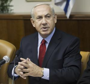 Israeli Prime Minister Benjamin Netanyahu gestures as he addresses the weekly cabinet meeting in Jerusalem, Sunday, Sept. 9, 2012. (AP Photo/Menahem Kahana, Pool)