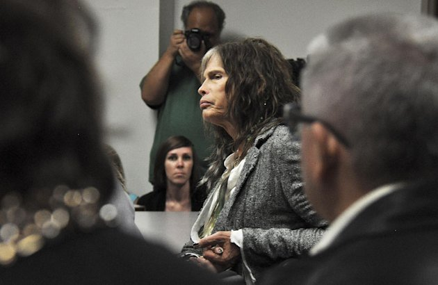 Aerosmith lead singer Steven Tyler listens to testimony on celebrity privacy during a hearing at the Hawaii Capitol in Honolulu on Friday, Feb. 8, 2013. Rock legends Steven Tyler and Mick Fleetwood convinced a Hawaii Senate committee on Friday to approve a bill to protect celebrities or anyone else from intrusive paparazzi. The state Senate Judiciary Committee approved the so-called Steven Tyler Act after the stars testified. The bill would give people power to sue others who take photos or video of their private lives in an offensive way. (AP Photo/Anita Hofschneider)