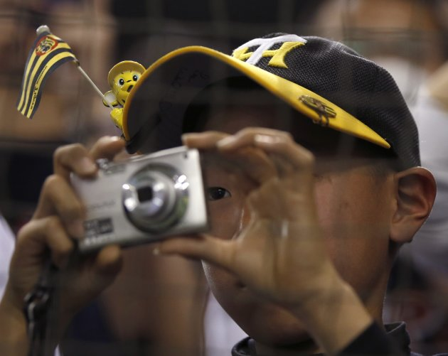 Fan takes photos before a game between Japan and Taiwan at the WBC second round in Tokyo