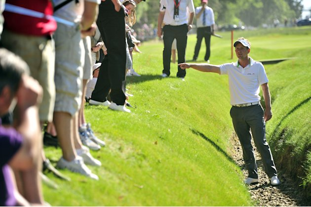 English golfer Luke Donald talks to the