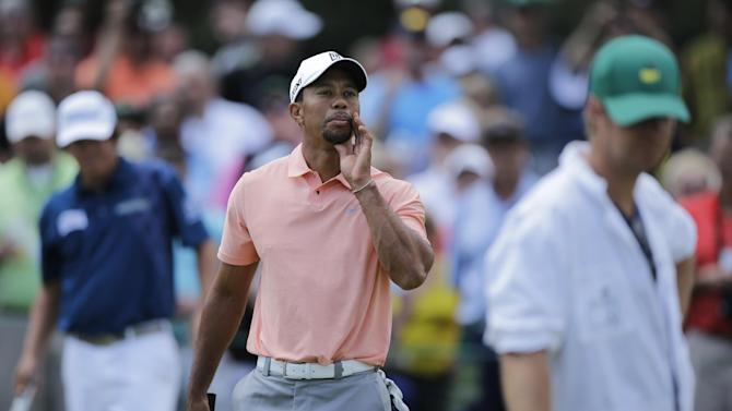 Tiger Woods yells out to his caddie on the driving range during a practice round for the Masters golf tournament Tuesday, April 9, 2013, in Augusta, Ga. (AP Photo/Matt Slocum)