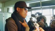 Former U.S. NBA basketball player Dennis Rodman speaks to the media at the airport before departing Pyongyang, March 1, 2013 in this still image taken from video. REUTERS/KCNA for Reuters TV