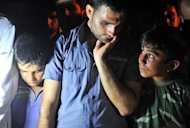 Syrians mourn during the funeral of 17 year old Free Syrian army member Mahmud Derwish after he was killed by the Syrian army during a clash at Bab al-Hawa near Idlib