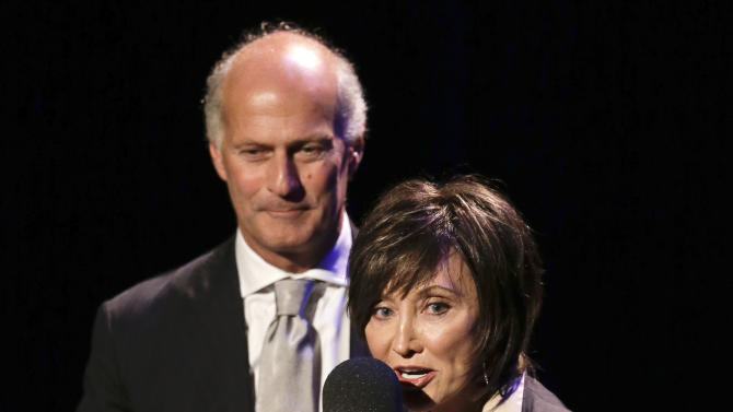 Country music star Pam Tillis and Italian bluegrass musician Martino Coppo, left, accept the guitar player of the year award on behalf of the late Doc Watson at the International Bluegrass Music Association Awards show on Thursday, Sept. 27, 2012, in Nashville, Tenn. (AP Photo/Mark Humphrey)