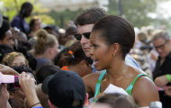 First lady Michelle Obama works the crowd while participating during the taping of Extreme Makeover Home Edition in Fayetteville, N.C., Thursday, July 21, 2011. (AP Photo/Gerry Broome)