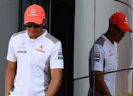Formula One driver Lewis Hamilton walks after a press conference at the Silverstone circuit ahead of the British Formula One Grand Prix. Hamilton is hoping that the latest upgrades to his McLaren car and significantly cooler conditions will boost his hopes of delivering a home win to enhance his title challenge in Sunday's British Grand Prix