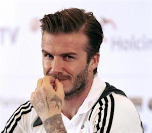 Los Angeles Galaxy's David Beckham reacts during a news confrence in Jakarta