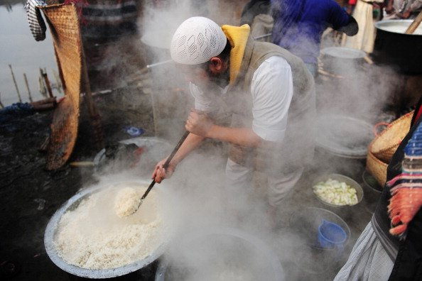 Muslim devotees cook at the World Muslim Congregation, also known as 'Biswa Ijtema', at Tongi, on the outskirts of Dhaka, on January 11, 2013. More then one million Muslim devotees attended prayers ne