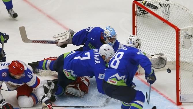 Russia's Kulyomin scores between Slovenia's Pretnar, goalkeeper Gracnar and Kranjc during their Ice Hockey World Championship game at the CEZ arena in Ostrava