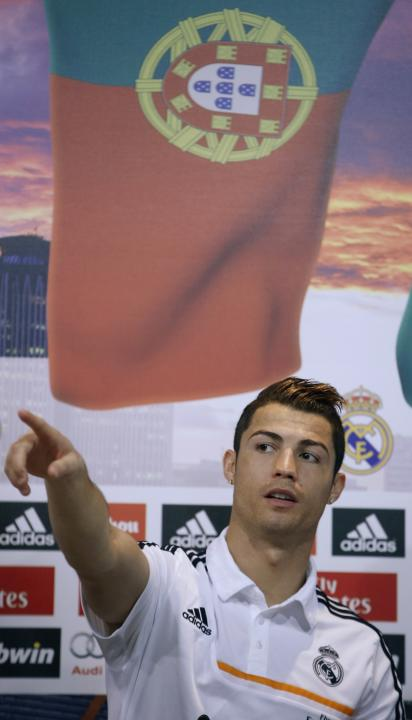 Real Madrid's Cristiano Ronaldo gestures during a news conference to discuss the draw for the 2014 World Cup at the Valdebebas training grounds, outside Madrid