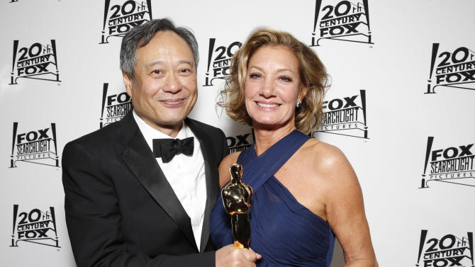 Director Ang Lee and Fox 2000 Pictures President Elizabeth Gabler attend the Twentieth Century Fox And Fox Searchlight Pictures Academy Awards Nominees Party at Lure on Sunday, February 24, 2013 in Los Angeles. (Photo by Todd Williamson/Invision for Fox Searchlight/AP)