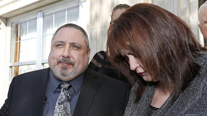 Michael Taylor, left, the father of murder victim Ashley Taylor, and Faye Taylor, right, her step-mother, talk to the media following the sentencing of Kevin Sweat in Okemah, Okla., Friday, Oct. 24, 2014. Sweat was sentenced to three life sentences. He pleaded guilty in the 2008 deaths of 11-year-old Skyla Whitaker and 13-year-old Taylor Paschal-Placker, whose deaths went unsolved until he was arrested in the 2011 killing of his fiancee, Ashley Taylor. (AP Photo/Sue Ogrocki)