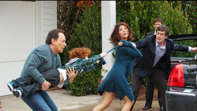 """FILE - This undated publicity file photo released by Twentieth Century Fox and Walden Media shows Billy Crystal, left, as Artie, holding on to his grandson, Kyle Harrison Breitkopf, as Barker, who doesn't like the idea of Marisa Tomei, center, as mother Alice and Tom Everett Scott as dad Phil leaving for a vacation in a scene from the film, """"Parental Guidance."""" (AP Photo/Twentieth Century Fox/Walden Media, Phil Caruso, File)"""
