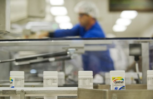 FILE- In this Thursday, July 12, 2012, file photo, Centrum multivitamins are shown on the packaging line at the Pfizer plant in Montreal Drugmaker Pfizer Inc. said Monday, Dec. , 2012, it is starting