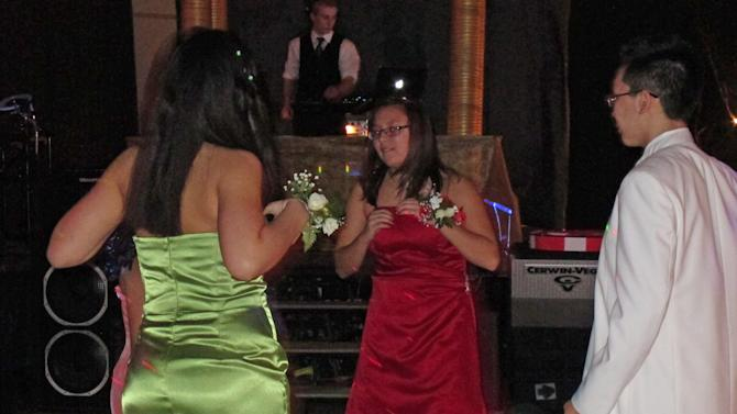 In this photo taken March 30, 2013, in Sitka, Alaska, students from Mount Edgecumbe High School dance at the annual prom. Mount Edgecumbe is Alaska's only boarding schools, and many of the 360 students who attended prom come from more than a hundred Alaska villages. Employees and retirees of Seattle-based Alaska Airlines are in the fifth year of securing donated dresses and bringing in hair stylists and nail artists to get the students ready for their prom. (AP Photo/Mark Thiessen)