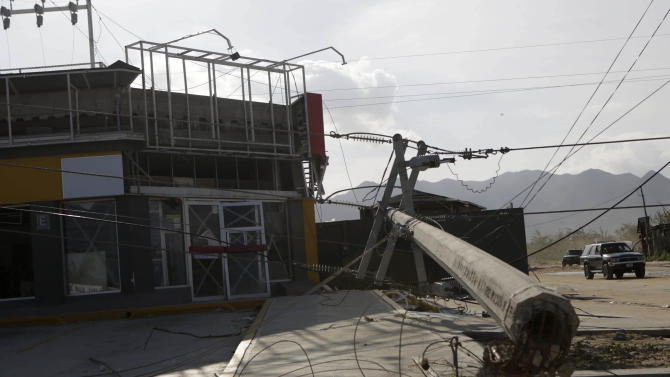 Knocked-down power lines are seen next to a store in San Jose del Cabo, after Hurricane Odile hit in Baja California