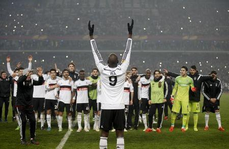 Ba of Besiktas celebrates victory in their Europa League round of 32 second leg soccer match against Liverpool in Istanbul