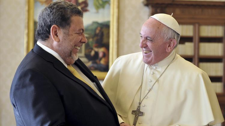 Pope Francis talks to Saint Vincent and the Grenadines' PM Gonsalves during a private audience at the Vatican