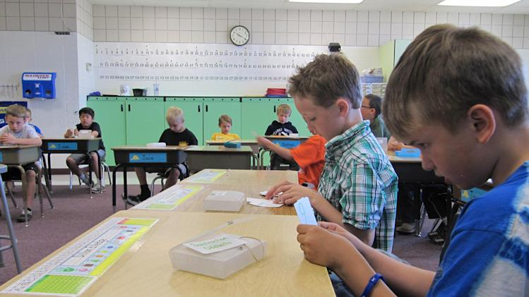 In this photo taken May 9, 2012, Dillon Elledge, 8, right, and Brody Kemble, 7, second from right, work with flash cards in their all-boys classroom at Middleton Heights Elementary in Middleton, Idaho.  Middleton is believed to be the only public school in Idaho offering all-boy and all-girl classrooms, though the movement is widespread in other states and is now being targeted by the American Civil Liberties Union in a bitter struggle over whether single-gender learning should be continued. (AP Photo/Jessie L. Bonner).