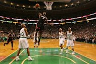 Miami Heat's LeBron James dunks during the second half of game four in their NBA Eastern Conference finals playoff series on June 3. James fouled out with 1:51 remaining, the first time he had fouled out since joining Miami two years ago