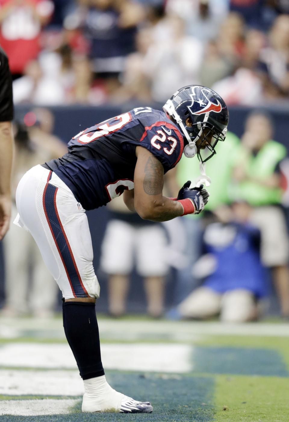 Houston Texans running back Arian Foster bows to the crowd after scoring a touchdown against the Tennessee Titans in the first quarter of an NFL football game Sunday, Sept. 30, 2012, in Houston. (AP Photo/Eric Gay)