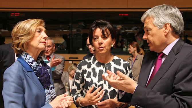 French Foreign Trade Minister Nicole Bricq, left, talks with Belgium's Foreign Minister Didier Reynders, right, and Germany's State Secretary for Trade Anne Ruth Herkes, during the EU Trade ministers meeting in Luxembourg, Friday June 14, 2013. France enters a key meeting of European Union trade ministers bent on keeping its audiovisual industry out of trans-Atlantic free trade negotiations, a move that would delay any opening of sweeping talks with the United States. (AP Photo/Yves Logghe)