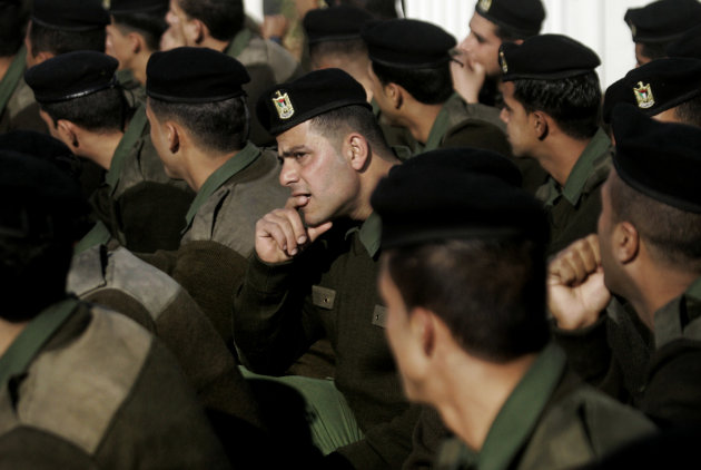 Palestinian security officers rest after a march marking the Fatah movement's 48th anniversary in the West Bank city of Nablus, Thursday, Jan. 3, 2013.(AP Photo/Nasser Ishtayeh)