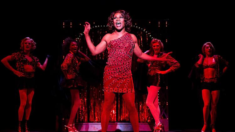"This theater image released by The O+M Company shows Billy Porter during a performance of ""Kinky Boots."" Producers of the Tony Award-winning musical said Thursday it has recouped its $13.5 million capitalization in 30 weeks. ""Kinky Boots"" is based on a real-life shoe factory that struggles until it finds new life in drag footwear. It has songs by Cyndi Lauper and a story by Harvey Fierstein. It won six Tonys, including best musical. (AP Photo/The O+M Company, Matthew Murphy)"
