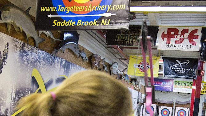 """In this April 13, 2012 photo, a young archery enthusiast participates in the youth archery league at Targeteers Archery in Saddle Brook, N.J. In schools and backyards, for their birthdays and out with their dads, kids are gaga for archery a month after the release of """"The Hunger Games."""" Archery ranges around the country have enjoyed a steady uptick among kids of both sexes in the movie's lead-up, though 16-year-old heroine Katniss Everdeen, the archery ace seems to resonate with girls more than boys. (AP Photo/Charles Sykes)"""