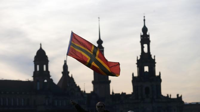 Supporters of the anti-Islam movement PEGIDA wave a flag during a demonstration in Dresden