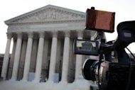 A TV camera in front of the US Supreme Court building in Washington DC. The court struck down most of Arizona's controversial new immigration law but upheld a key provision allowing officers to do spot checks of people's identity papers