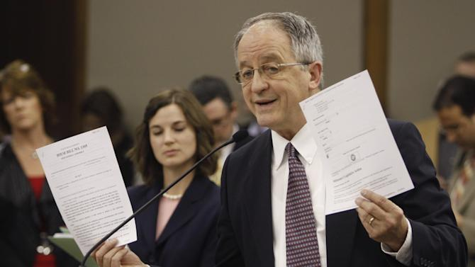 Del. Robert Marshall, R-Prince William, holds up papers during his presention on his Parenthood bill during a meeting of the Senate Education and Health committee at the Capitol in Richmond, Va., Thursday, Feb. 23, 2012.  (AP Photo/Steve Helber)