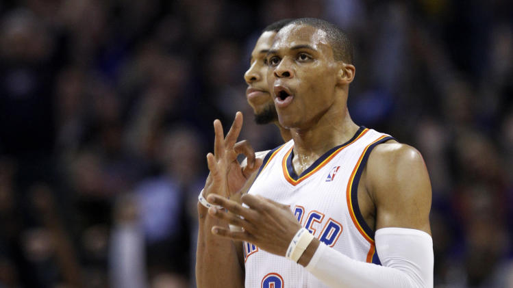 Oklahoma City Thunder guard Russell Westbrook gestures after hitting a 3-point shot to end the first quarter of an NBA basketball game against the Los Angeles Lakers in Oklahoma City, Friday, Dec. 7, 2012. Lakers' Darius Morris is at rear (AP Photo/Sue Ogrocki)