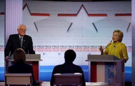 Clinton and Sanders battle in debate over healthcare, Wall Street ties