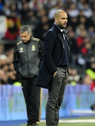 Barcelona's coach Josep Guardiola (R), seen here along with Real Madrid's coach Jose Mourinho during the Spanish Cup 'El Clasico' match at the Santiago Barnabeu stadium in Madrid, in January. Bitter rivals Barcelona and Real Madrid meet on Saturday in the sixth Clasico of the season to fight for three crucial points that will shape the destiny of this season's La Liga title
