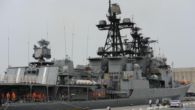 FILE - In this Friday, May 17, 2013 file photo Russian sailors are seen aboard the Admiral Panteleyev Russian war ship moored at the Cypriot port of Limassol. Russia's Defense Ministry said Thursday it had replaced all its military personnel with civilian workers at the naval base in the Syrian port of Tartus, the only such outpost Russia has outside the former Soviet Union. (AP Photo/Pavlos Vrionides)