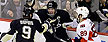 Pittsburgh Penguins&#39; Sidney Crosby (87) celebrates scoring his second goal of the first period with teammate Pascal Dupuis (9) as Ottawa Senators&#39; Cory Conacher (89) skates back to his bench during Game 2 of an NHL hockey Stanley Cup second-round playoff series, in Pittsburgh on Friday, May 17, 2013.(AP Photo/Gene J. Puskar)