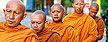 Buddhist monks taking up morning alms in Pattani province, southern Thailand. (AP Photo/Apichart Weerawong)