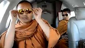 Thai monks scolded for flying by jet