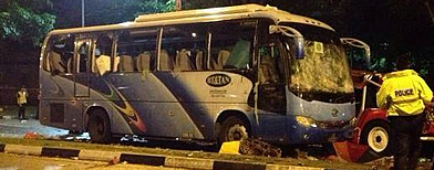 Rioters smash private bus