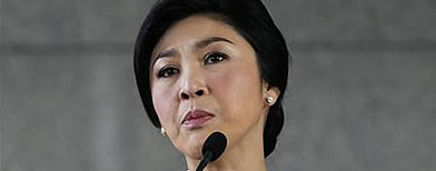 Thai PM Yingluck Shinawatra is on the verge of tears as she calls on street protesters to go home.