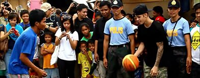 Justin Bieber visits typhoon victims in the Philippines and brings joy with a game of basketball.