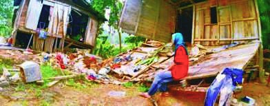 Only some trees stopped a Malaysian house from being washed away by heavy flood.