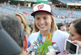 Katie Ledecky gives gold medals to Bryce Harper before throwing out first pitch