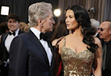 Catherine Zeta Jones gives Michael Douglas a joint birthday kiss