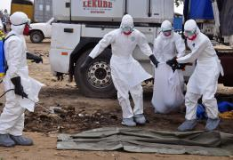 Health workers carry the body of a man found in the street, suspected of dying from the ebola virus, in the capital city of Monrovia, Liberia, Tuesday, Aug. 12, 2014. The World Health Organization declared it's ethical to use untested drugs and vaccines in the ongoing Ebola outbreak in West Africa although the tiny supply of one experimental drug handed out to three people has been depleted and it could be many months until more is available. (AP Photo/Abbas Dulleh)