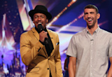 Michael Phelps Cheered On By Baby Boomer & Fiancee Nicole Johnson As He Co-Hosts 'America's Got Talent'