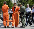 Activists wearing orange jumpsuits are arrested during a protest marking the 100th day of prisoners&#39; hunger strike at Guantanamo Bay in front of the White House