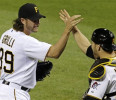 Pittsburgh Pirates closer Jason Grilli, left, celebrates with catcher Russell Martin after getting the final out of a 5-4 win over the Chicago Cubs in a baseball game in Pittsburgh Tuesday, May 21 ...